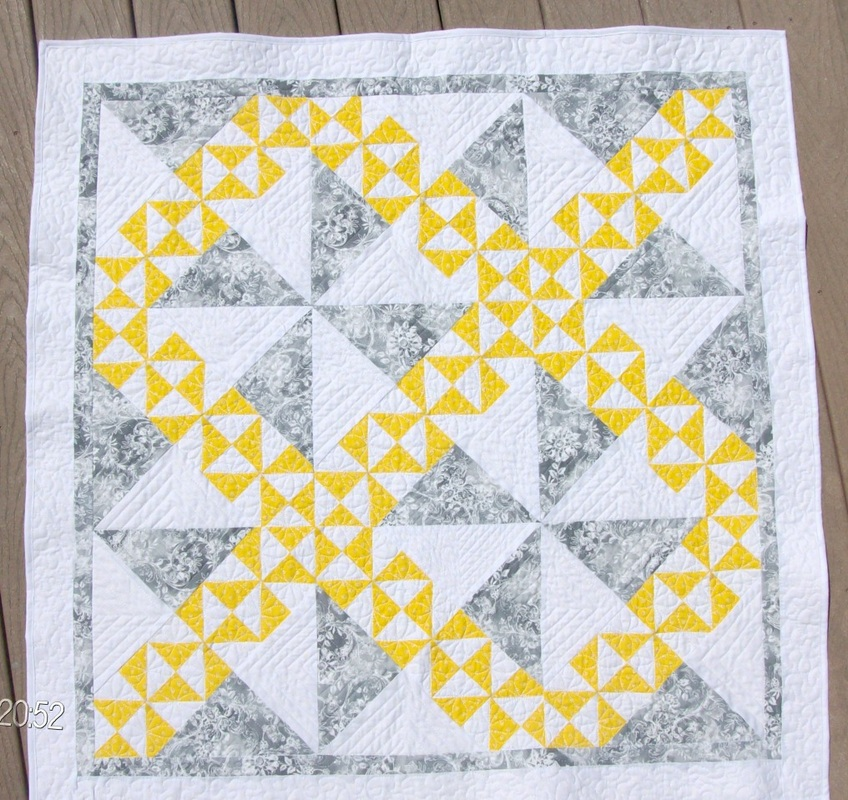 I turned the starry path quilt block into a beautiful baby quilt.