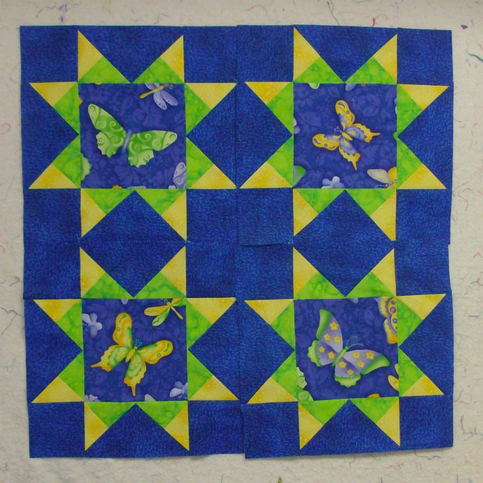 Four quilt blocks together of the Arm Star Quilt Block.