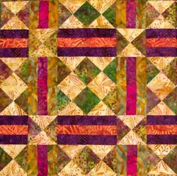 Four squares of Chain and Hourglass Quilt Block.
