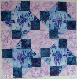Four blocks together of Paper Pinwheels by Judy Hopkins made by Homesewn by Carolyn