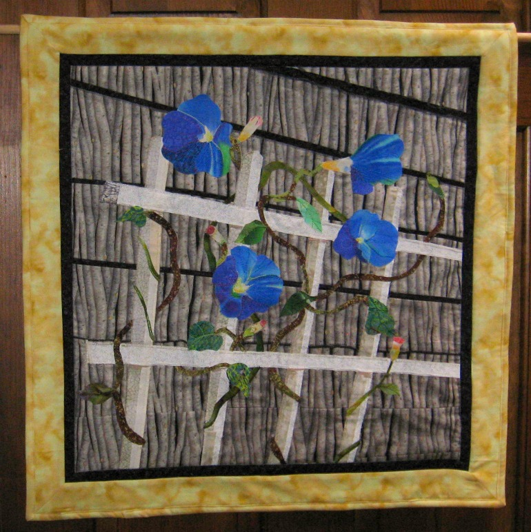 Beautiful Morning Glory wall hanging created by Carolyn taken from a photo off the coast of Maine.