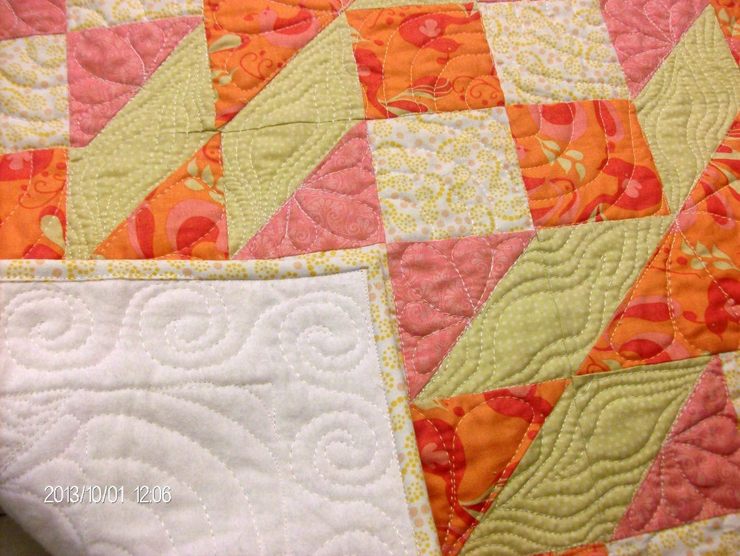 Beautiful baby quilt made with the Double X No. 3 quilt block.