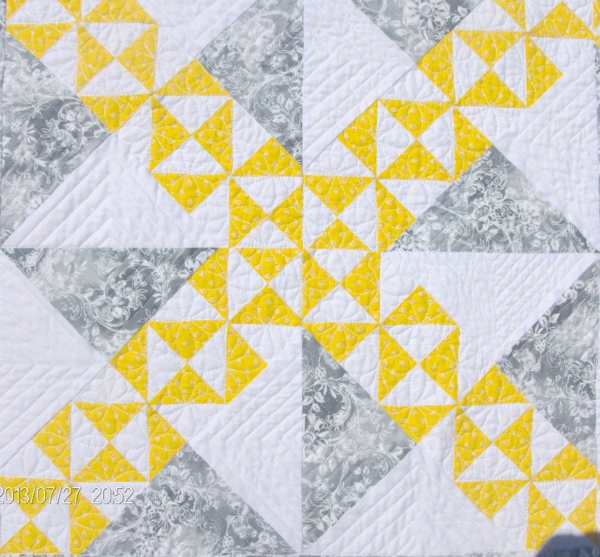 Four quilt blocks of the Starry Path quilt block.
