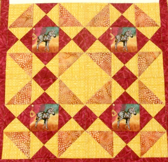 Four squares of Swamp Angel Quilt Block.