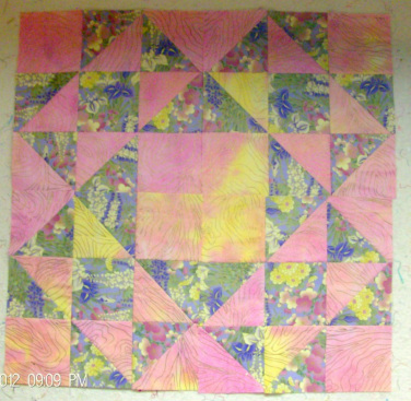 Four Quilt Blocks together of Split Nine Patch Quilt Block
