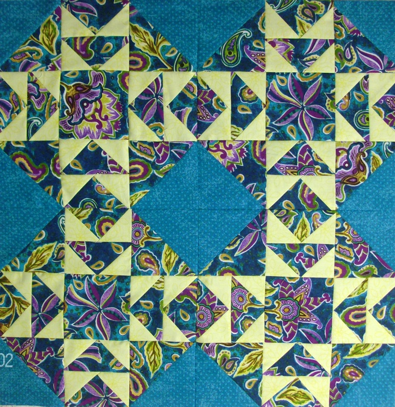 Cut the Corners four quilt blocks sewn together.