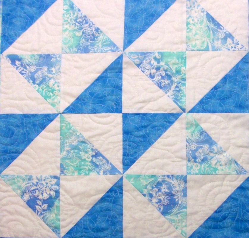 Quilting blog about four squares of the double square quilt block.