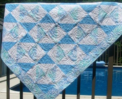 I have free motion quilted spirals throughout this sweet boy baby quilt.