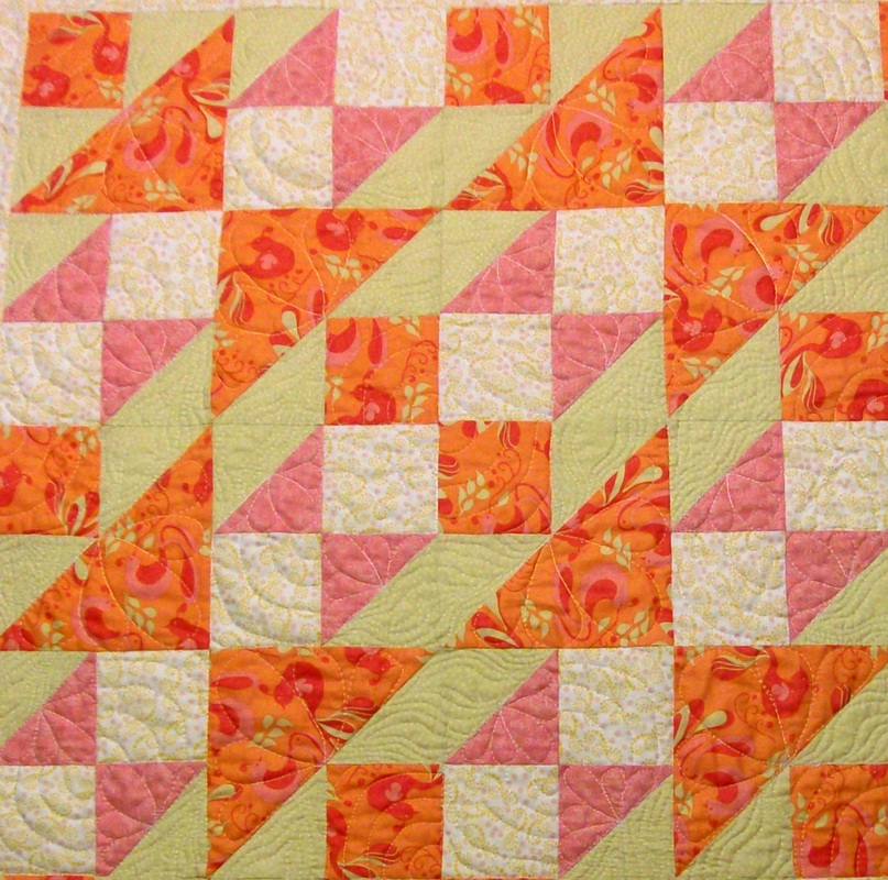 Four quilt blocks sewn together of the Double X No. 3 block showing a new design.