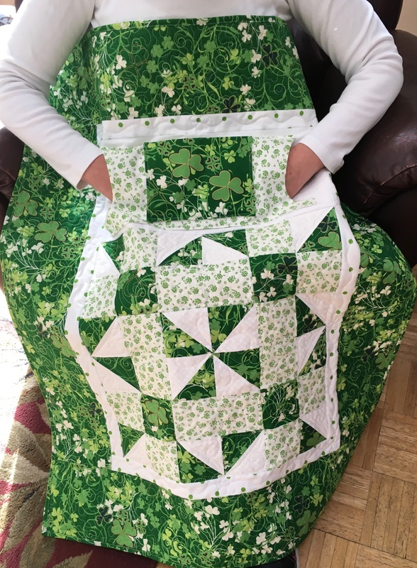 Shamrock Lovie Lap Quilt with Pockets from http://www.homesewnbycarolyn.com