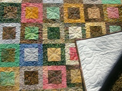 Buy lap quilt with beautiful batik fabrics and machine free motio quilted by Homesewn by Carolyn.  This batik quilt would look great on your sofa.