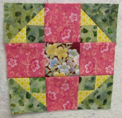 Floral Album Lap Quilt with pockets for wheelchairs or people in nursing homes.