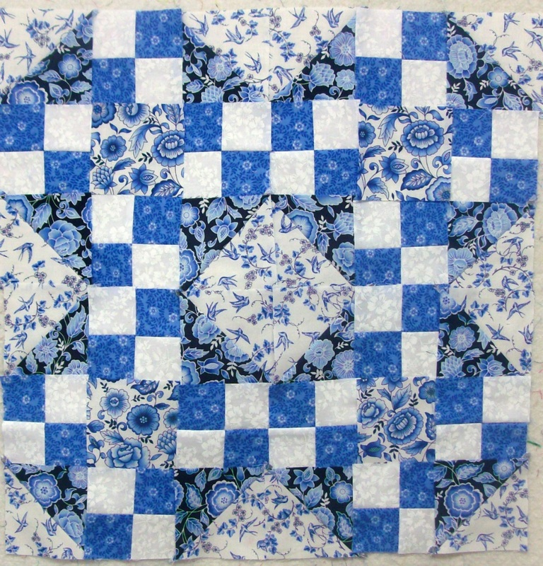 Quilting blog four blocks sewn together of the true blue quilt block.