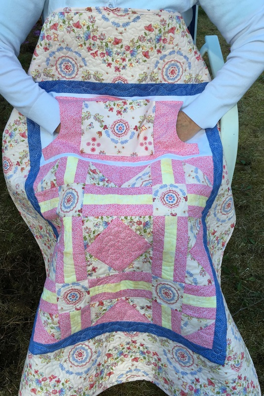Pretty in Pink Lovie Lap Quilt with Pockets from http://www.HomeSewnByCarolyn.com