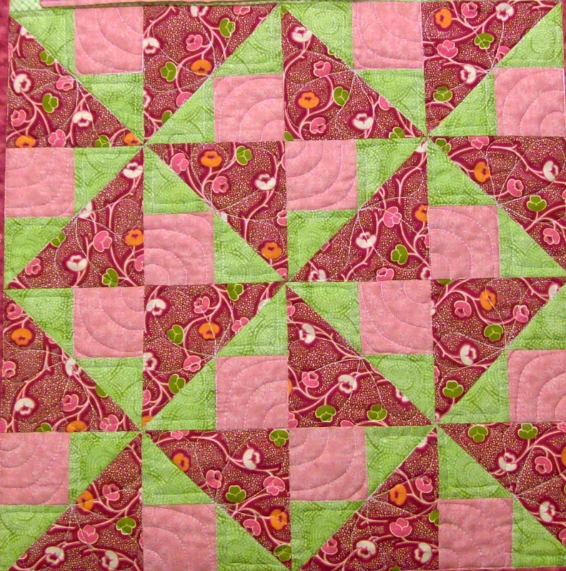 Spinner quilt blocks sewn together.