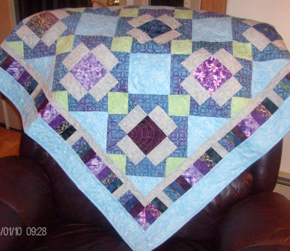 Big T lap quilt made by Homesewn by Carolyn.
