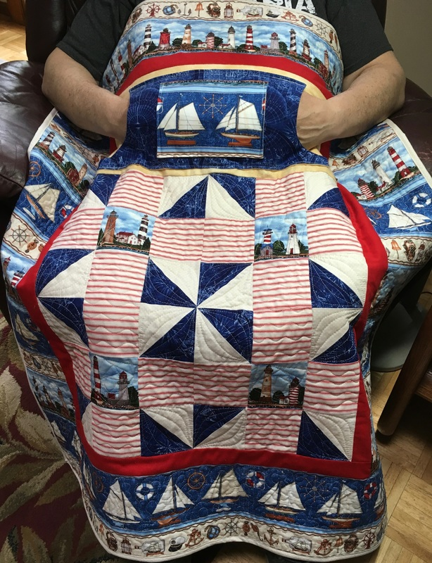 Lighthouse Lovie Lap Quilt with Pockets, handmade wheelchair blanket from http://www.HomeSewnByCarolyn.com