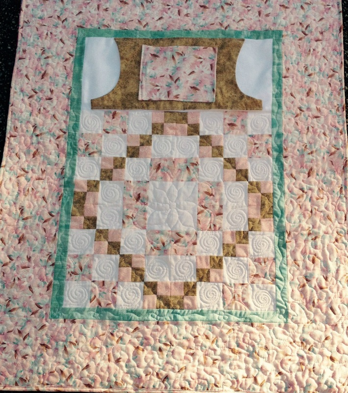 Soft and sweet lap quilt with pockets from http://www.homesewnbycarolyn.com