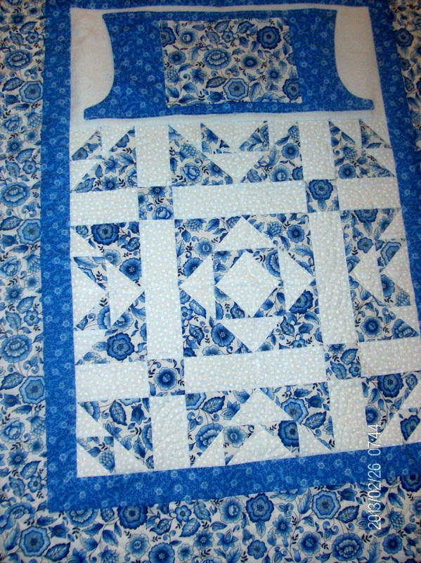 Beautiful blue and white lap quilt from Homesewn by Carolyn