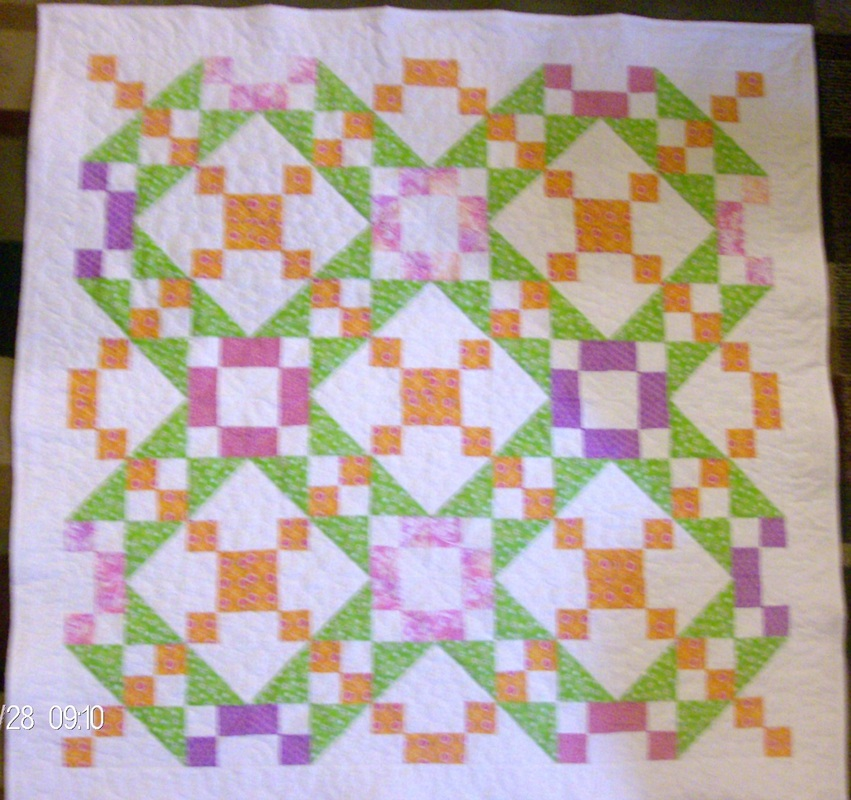 Quilting Blog discussing the Underground Railroad quilt block, turning it into a baby quilt.