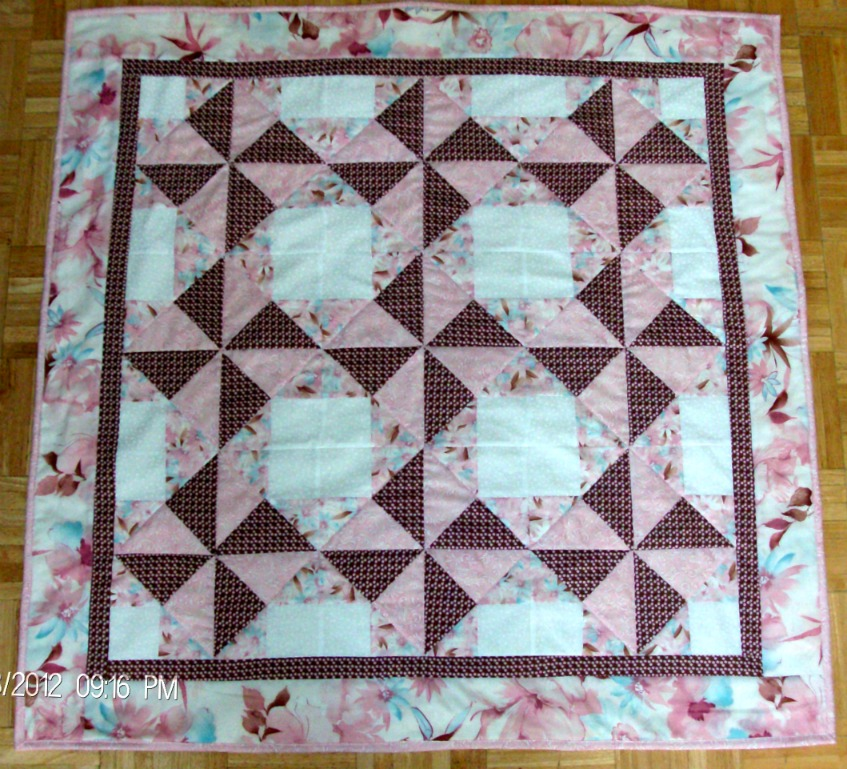Windmill Baby Quilt, beautiful soft pink, brown, white and turquoise.