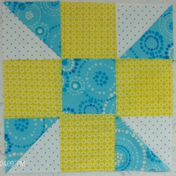Calico Puzzle Baby Quilt by Homesewn by Carolyn, lap quilt