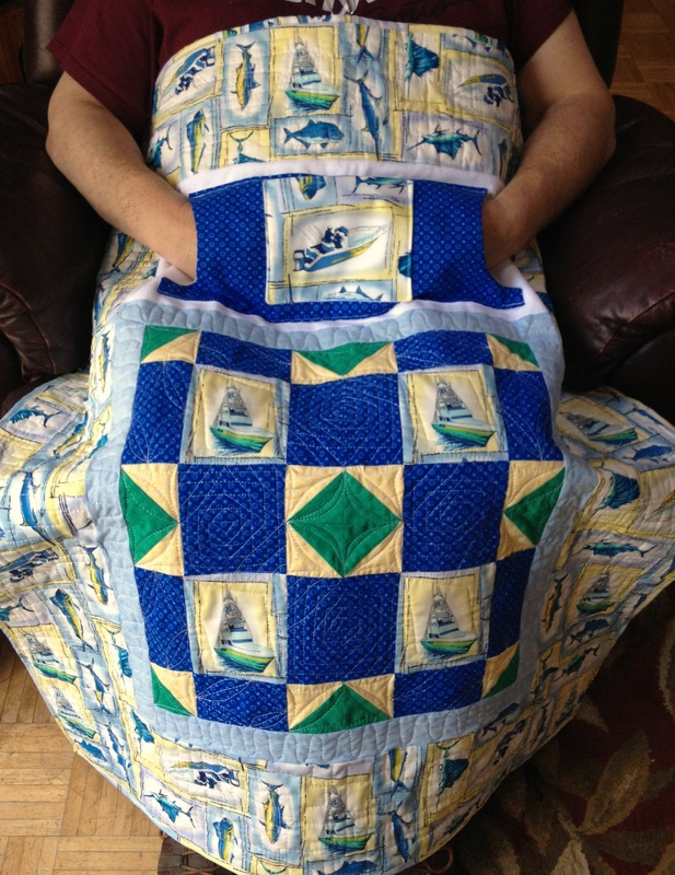 Gone Fishing Lap Quilt with Pockets.  Great gift for Dad or Grandpa.  To purchase - http://www.homesewnbycarolyn.com, click on Lovie Lap Quilts!