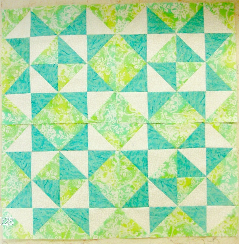 Quilt Blog by Homesewn by Carolyn speaking about four quilt blocks sewn together of the Wheel of Time quilt block.