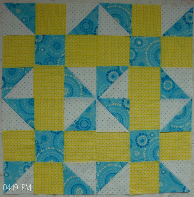 Four blocks together of calico puzzle quilt pattern