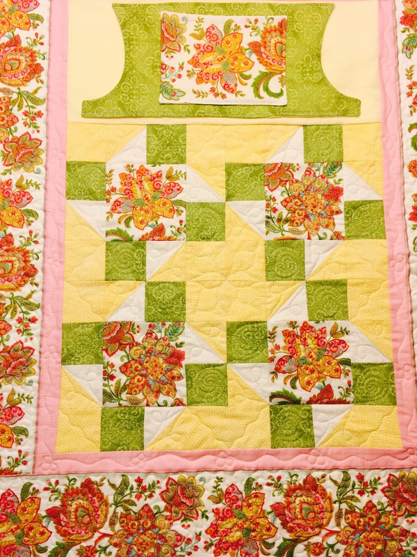 Yellow and Green Lovie Lap Quilt with pockets from http://www.homesewnbycarolyn.com