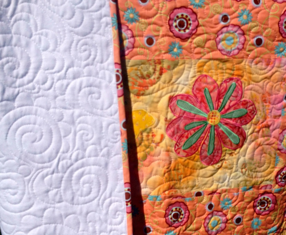 Peach Butterfly and Floral quilt from http://www.homesewnbycarolyn.com