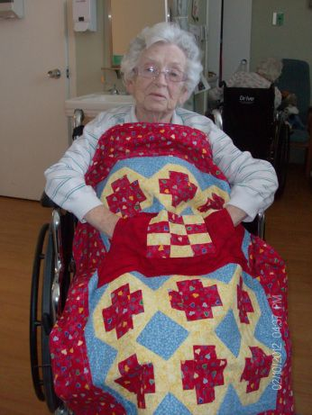My Grandmother with her Lovie Lap Quilt with Pockets.  I designed this quilt especially for my Grandmother.  http://www.homesewnbycarolyn.com