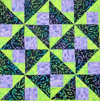 Four blocks of Brave World quilt pattern.