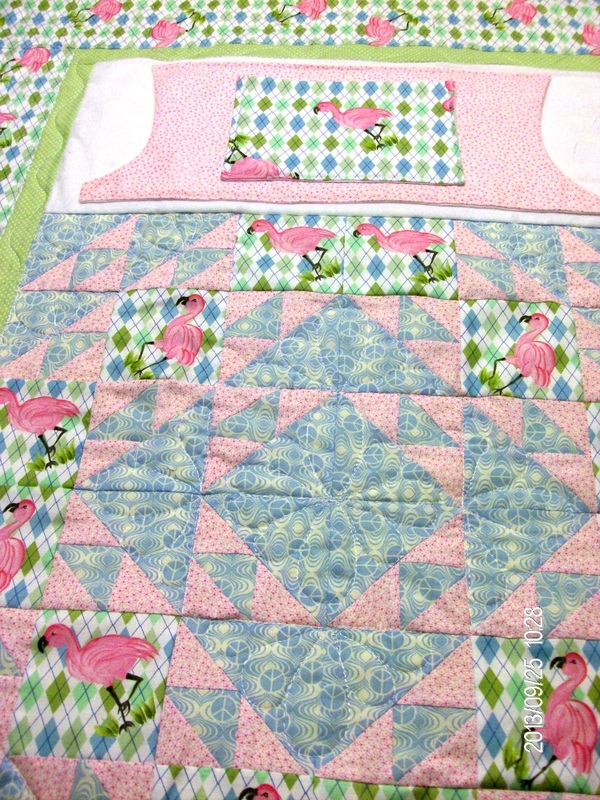 Beautiful handmade lap quilt with pockets.