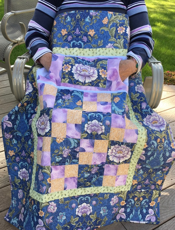 Beautiful Lovie Lap Quilt with Pockets for sale from http://www.HomeSewnByCarolyn.com