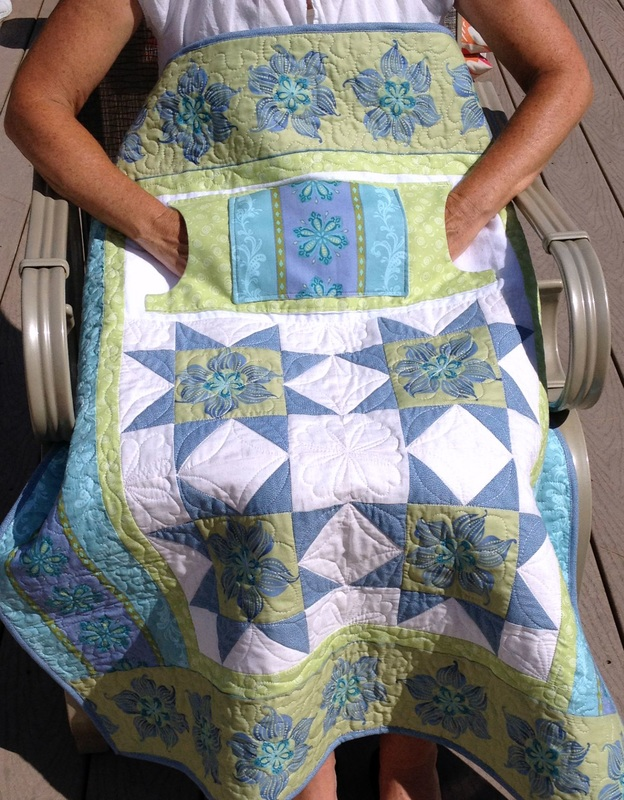 Lovie Lap Quilt with Pockets from http://www.homesewnbycarolyn.com