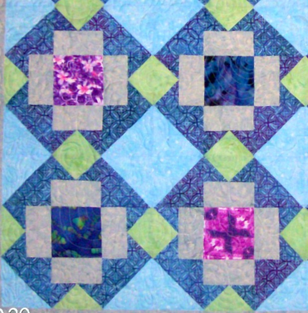 Four Big T quilt blocks sewn together.