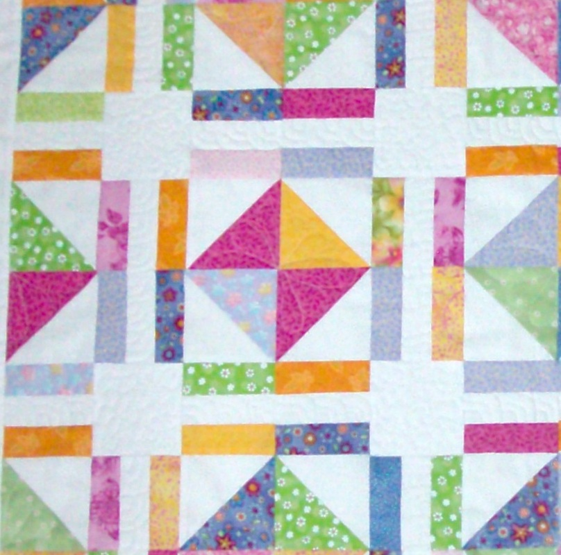 Friendship Quilt four blocks sewn together from Homesewn by Caroyn.