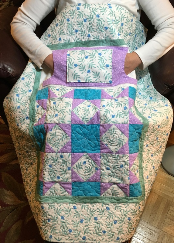Green Leaf Lovie Lap Quilt with Pockets from http://www.HomeSewnByCarolyn.com