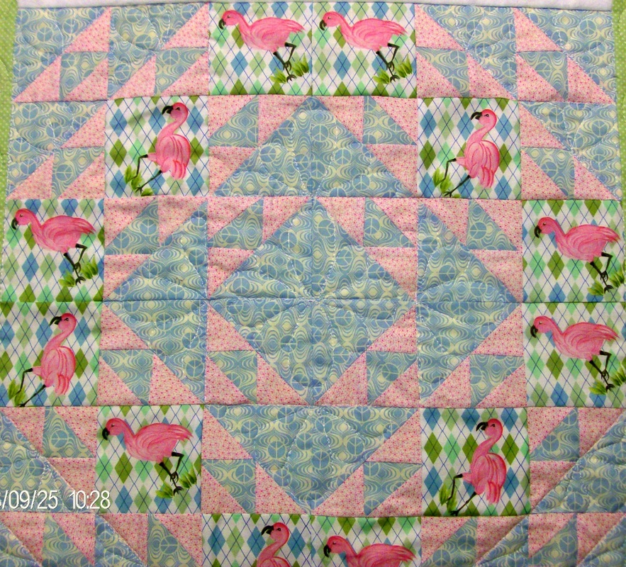 Four quilt blocks sewn together of the Cat's Cradle quilt block.