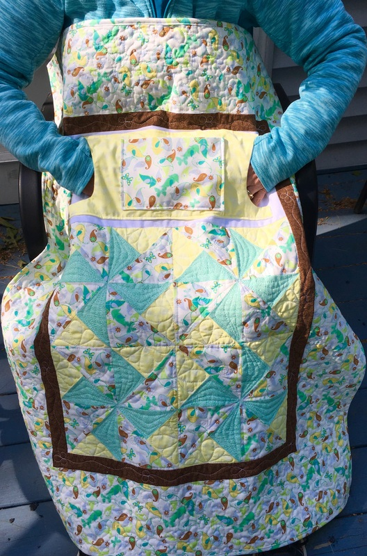 Yellow and Green Lovie Lap Quilt with Pockets, great for nursing home or wheelchairs.  Made by http://www.HomeSewnByCarolyn.com
