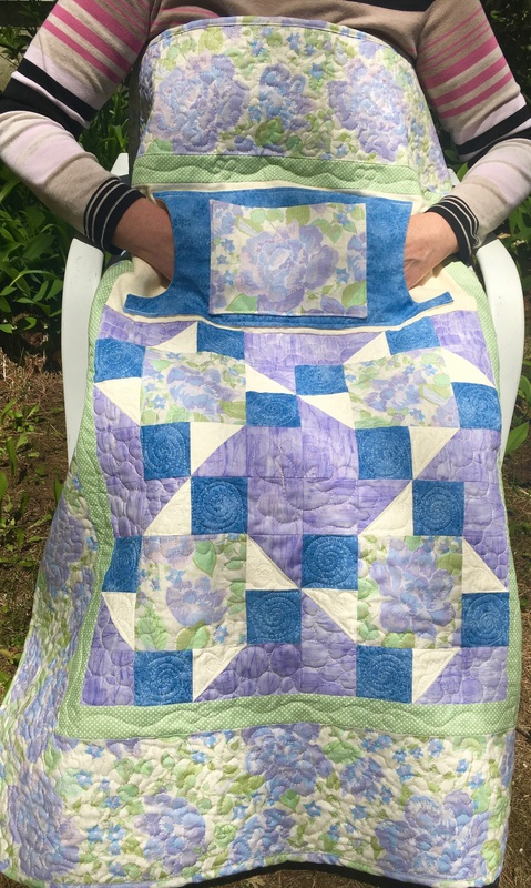 Floral Lilac Lovie Lap Quilt with Pockets from http://www.HomeSewnByCarolyn.com