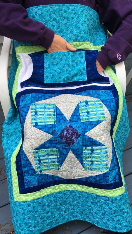 Handmade Wheelchair lap quilt with pockets from http://www.HomeSewnByCarolyn.com