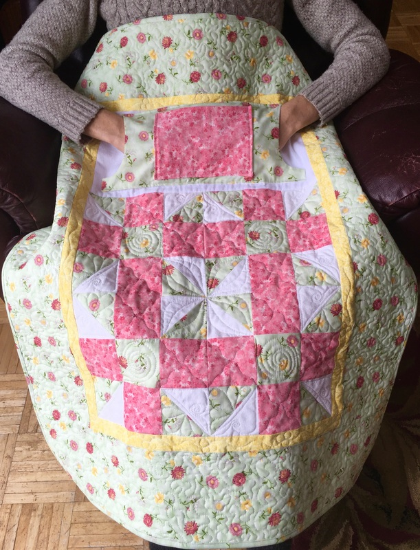 Spring Floral Lovie Lap Quilt with Pockets by http://www.HomeSewnByCarolyn.com