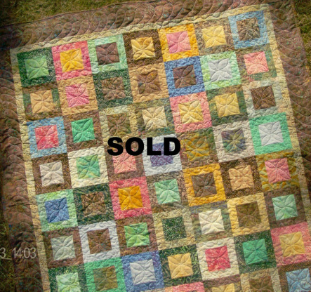 Beautiful Batik Lap Quilt for sale by Homesewn by Carolyn.  This quilt is machine pieced and machine free motion quilted using several designs.