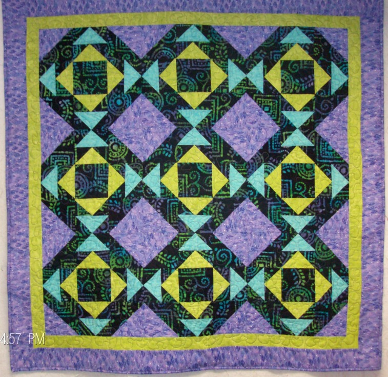 Cups and Saucers Lap Quilt made with batik fabrics.
