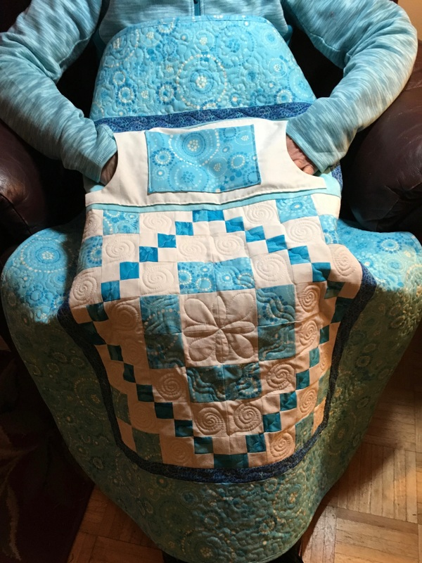 Turquoise Lovie Lap Quilt with Pockets from http://www.homesewnbycarolyn.com