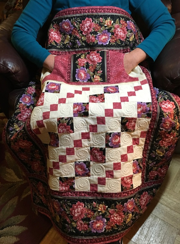 Dusty Rose Lovie Lap Quilt with pockets, great gift for Mom or Grandma.  Shop at http://www.homesewnbycarolyn.com