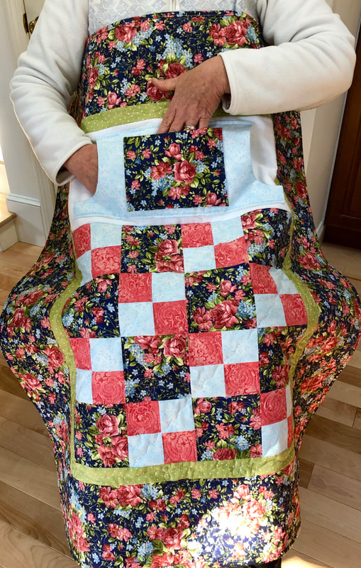 Pink Roses Lovie Lap Quilt with Pockets, great gift for Mom or Grandma from http://www.HomeSewnByCarolyn.com