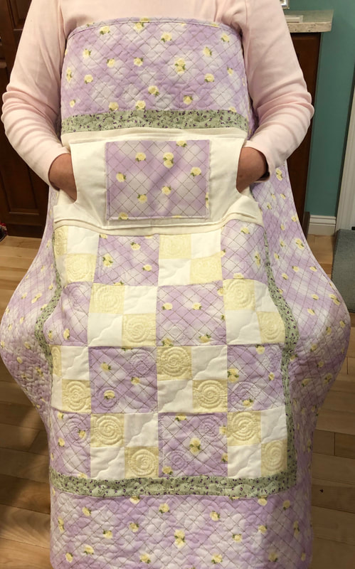 Delicate Rose Lovie Lap Quilt with Pockets from http://www.HomeSewnByCarolyn.com